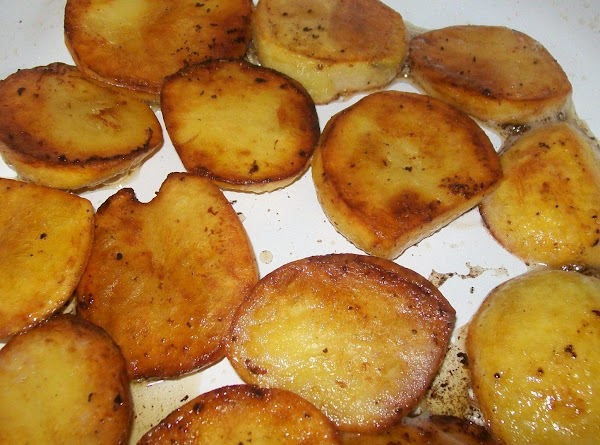 Lay the potatoes in the bottom of the pan and get one side browned.