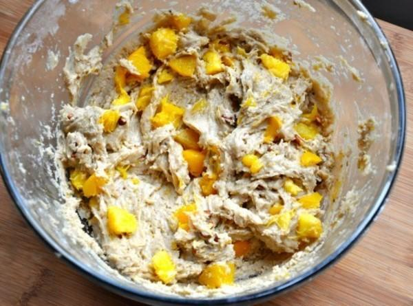 Mix melted butter with sugar. Add yogert and vanilla and mix well. Add diced...
