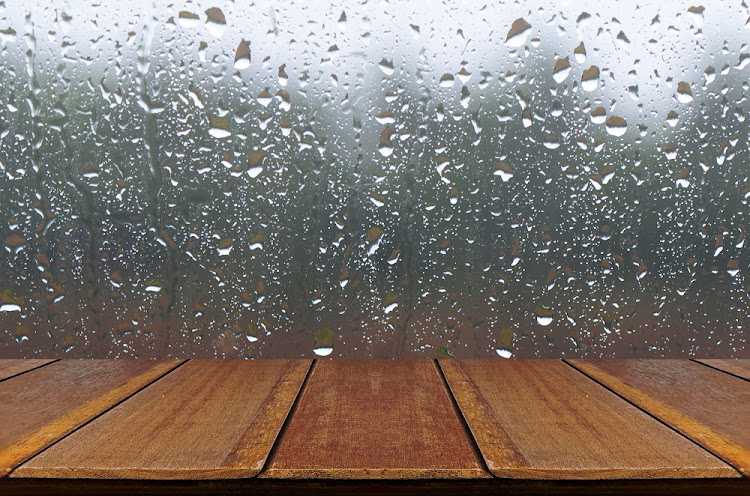 Rain Drops on Glass Window Background with Wood Table.
