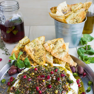 Labneh Dip with Zaatar Pistachio Mint Olive Topping.