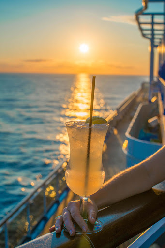 cocktail-at-sunset.jpg - Enjoy a tall, cool drink while you watch the sunset on Carnival Vista.