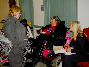 Photo: Bonnie Hitch of DART speaks with Jamie Wolfe during Disability Day at Legislative Hall on 3.25.15.