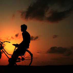 eventide by Anvar Sadath - Landscapes Beaches ( image, still, solitude, seascape, seaside, photo, boy, photography, man, bicycle )