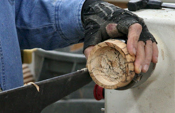 Photo: Here he puts the wood in the chuck and hollows it out to accept the jar's metal top. The top of the top can be completed on a jam chuck.