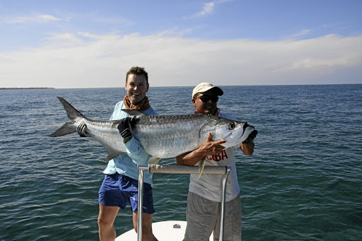 Big time: On the ocean, fly-fishermen need good balance and strength because a trophy may weigh as much as 70kg. Picture: SUPPLIED