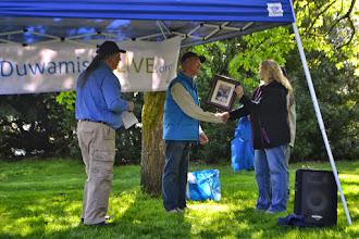 Photo: Scott Blackstock who leads efforts at Roxhill Bog accepting his John Beal Environmental Stewardship Volunteer Award