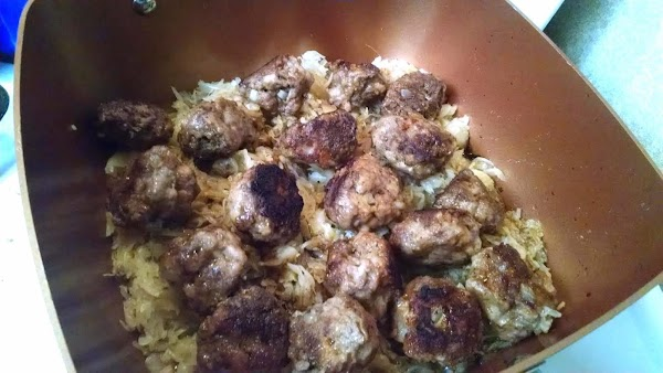 Place the sauerkraut in the skillet and top with the meatballs.