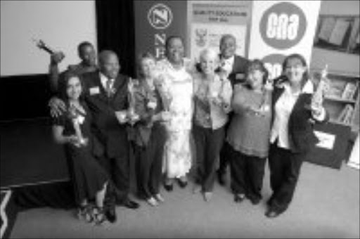 OUTSTANDING ACHIEVEMENT: Representatives of the winning schools in the Readthon 2006 competition and Education Minister Naledi Pandor, centre, at the awards ceremony at the READ Education offices in Pretoria last month. © Sowetan.