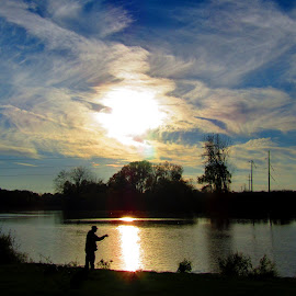 Gone Fishing by Howard Sharper - Sports & Fitness Watersports ( reflection, fishing, sunset, silhouette, cloudscape, riverside, fisherman,  )