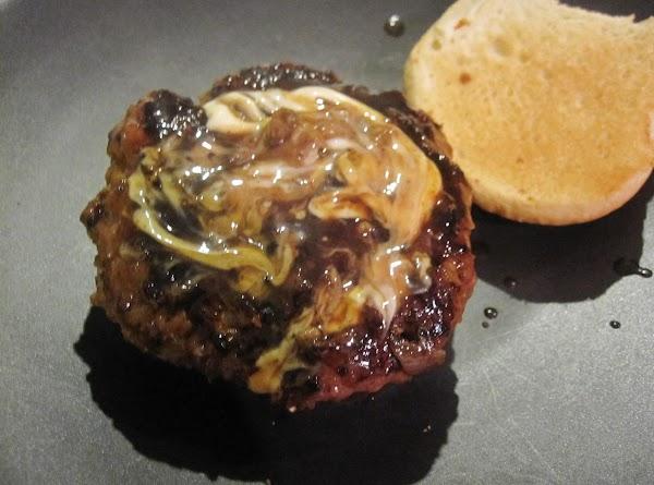 Then dredge hamburger patties in teriyaki sauce. Put the patty on the hamburger bun. Then...