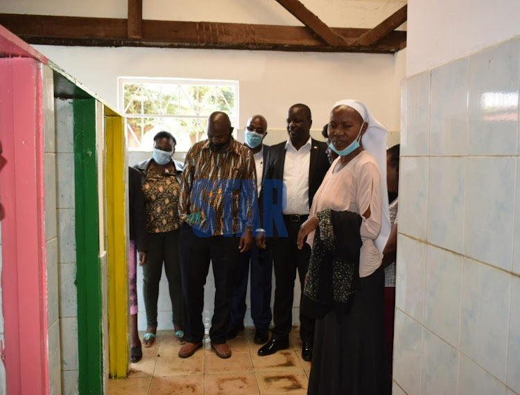 Teachers and PTA members of Moi Avenue Primary check on the newly built toilets on September 28, 2020 ahead of reopening