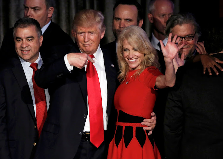 Then US president-elect Donald Trump and his campaign manager Kellyanne Conway greet supporters during his election night rally in Manhattan, New York in November 2016. Picture: REUTERS