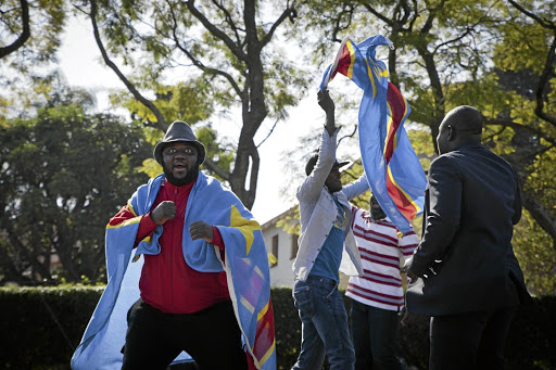 NO FANS OF KABILA: Congolese people protest outside the presidential guesthouse in Pretoria where President Zuma was meeting DRC President Joseph Kabila Picture: MADELENE CRONJE