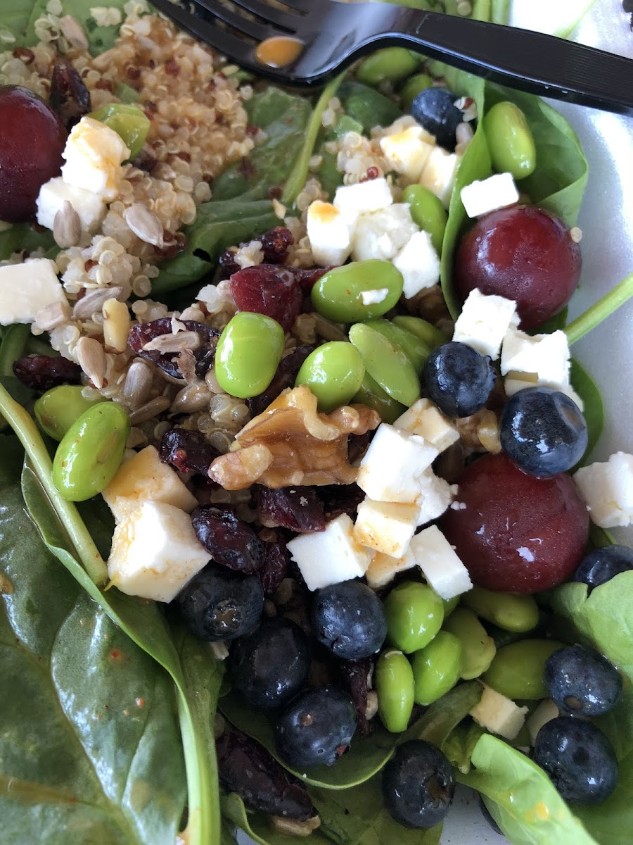 Salad with spinach, feta, edamame, craisins and walnuts