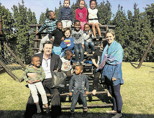 SOUND IDEA: Premier Hotel Group food and beverage manager Bruce Mckay, who started the Let's Hear Foundation, with children at the Carel du Toit Centre, and principal Paula Kumm. McKay's foundation donated 40 refurbished hearing aids to the centre. Picture: SUPPLIED