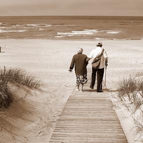 couple by Vygintas Domanskis - People Couples ( shore, water, dunes, waterscape, couple, seascape, beach,  )