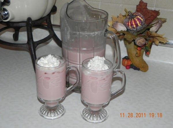 Combine cranberry-raspberry juice & eggnog in a pitcher. Carefully add lemon-lime beverage. Dollop each...