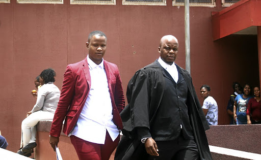 'Idols SA' runner-up Mthokozisi Ndaba with his lawyer James Ndebele at the Hillbrow Magistrate's Court, where his assault charge was withdrawn. /Kabelo Mokoena