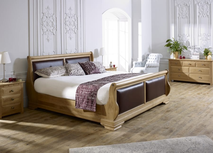 The Tuscany Sleigh Bed in Natural Oak with Dark Grape leather