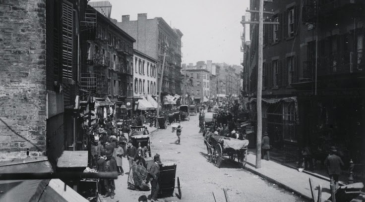 Mulberry St in 1890. The buildings to the left are where Columbus Park stands now.  From the Museum of the City of New York.