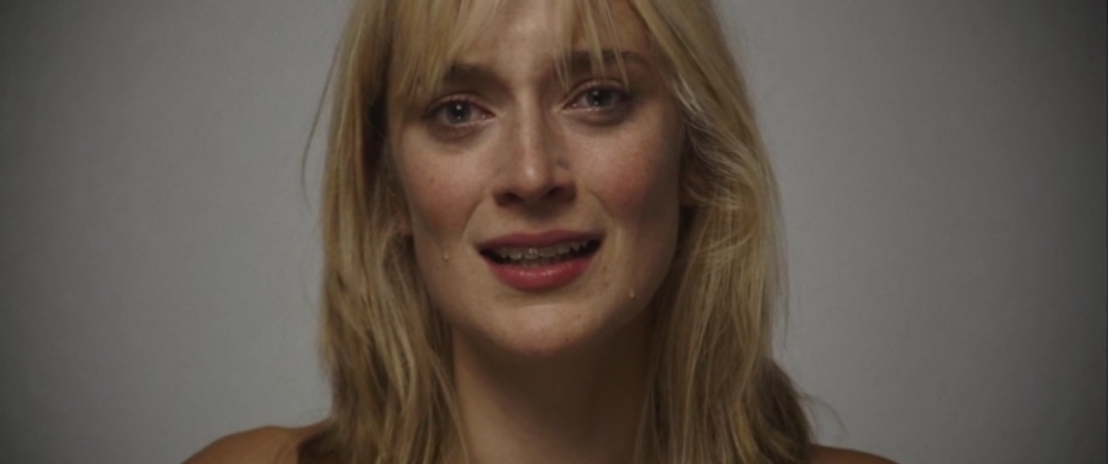 Beth (Fitzgerald) tearfully performs a horror scene to the camera.