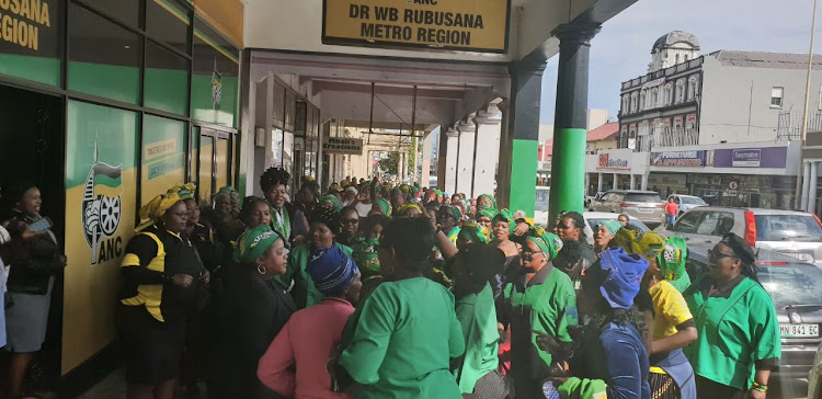 Supporters of Dr WB Rubusana chairman Pumlani Mkolo outside the party's regional offices.