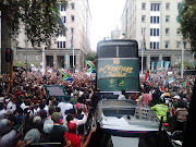 As the Bokkes open tour bus made its way amongst thousands of people at Bank City in the Johannesburg CBD, they were welcomed with confetti and the famous Nkalakatha song.
