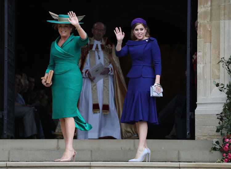 The bride's mother and sister, Sarah Ferguson and Princess Beatrice of York, arrive at Windsor Castle on October 12 2018.