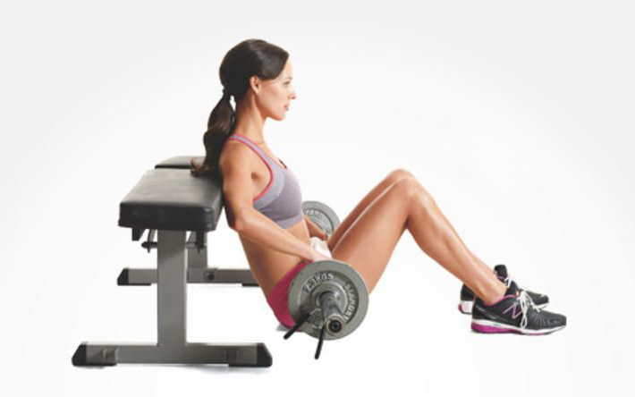 Add weight to hip thrusts to advance the exercise and strengthen glutes.