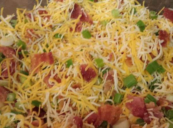 In a bowl mix together the cheese, bacon and green onions and top the...