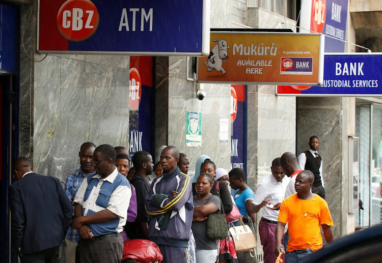 Zimbabweans queue outside a bank in Harare, Zimbabwe, February 26 2019. Picture: REUTERS/PHILIMON BULAWAYO