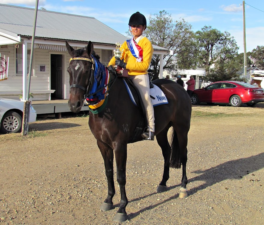 Laura Finlay with the Neridah Oliphant Horsemanship Challenge Memorial Trophy and her many ribbons which she won at the recent two-day Zone Five Jamboree held in Boggabri.