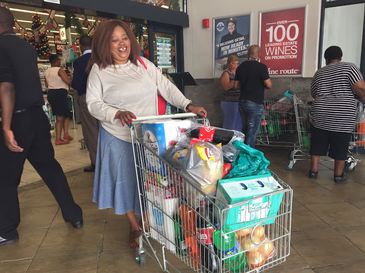 A lady leaves Checkers Sunninghill after shopping. Picture: JESSICA LEVITT