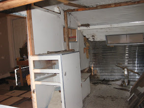 Photo: Only cabinet left was the one just inside the door.  was pretty solid, but no drawers or cabinet door.