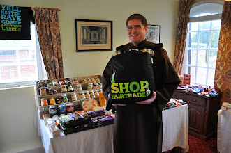 Photo: Friar Ged with Fairtrade bag of goodies