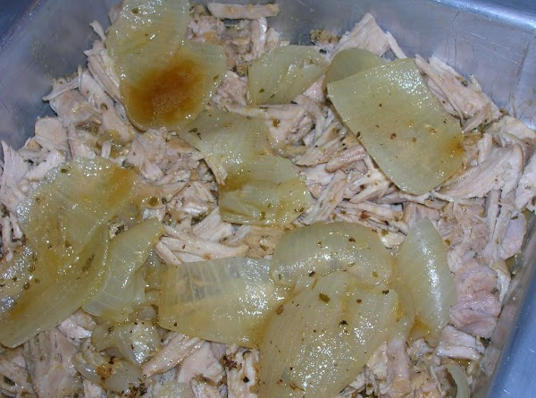 Remove the orange halves from the pot and discard. Place the Dutch oven with...