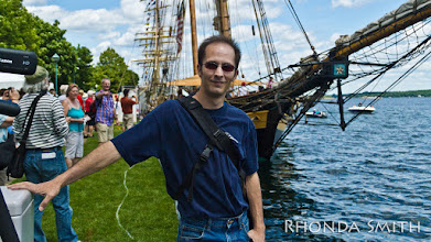 Photo: Steve posing for the camera in front of the unknown ship.