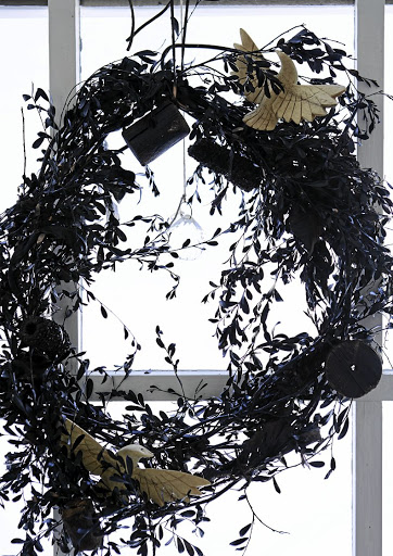 The wreath hanging was made by Shelley using indigenous Cape fynbos.