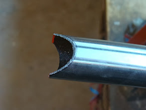 Photo: After cutting both the top and bottom parts of the miter with a hacksaw.