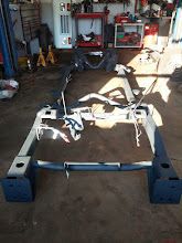 Photo: Now we bring in a new frame, and must rebuild it from the ground up, using all of the old key components.