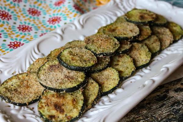 Zucchini Chips On A White Platter.