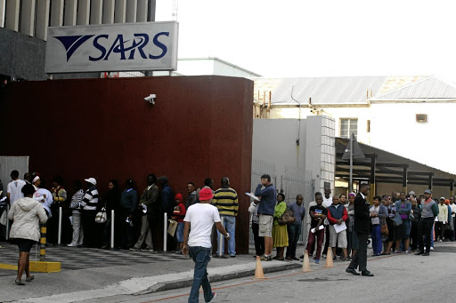 Taxing queues: Taxpayers wait to be assisted with their income tax returns at the SARS office in Port Elizabeth. There is still no word on the release of a taxpayer bill of rights. Picture: FREDLIN ADRIAAN