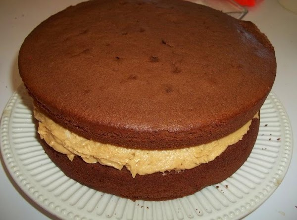 Now, place the other cake layer rounded side up on top of the peanut...