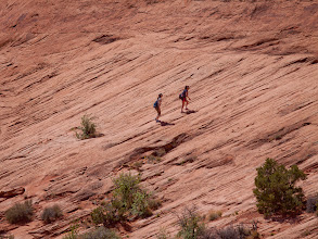 Photo: Two participants hiking up to the Corona Arch during the Adventure Rabbi Passover in Moab retreat.