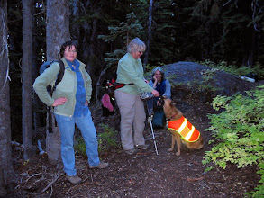 Photo: Hiking back to camp. (L-R) Polly, Linda, Celia, and Kiona (dog). Photo by Jane