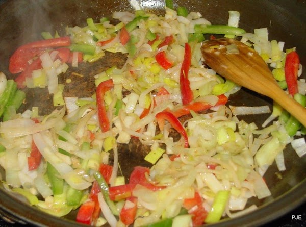 Turn the heat down to medium and sauté the onions in the remaining fat...