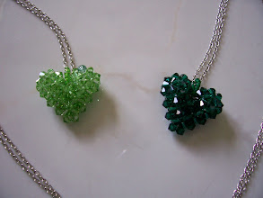"Photo: Swarovski Crystal Heart. Size: 1"" x 1"" face and 1/2"" thick with 18"" chain. Color left to right: Peridot or Peridot AB, Emerald. $35.00 each."