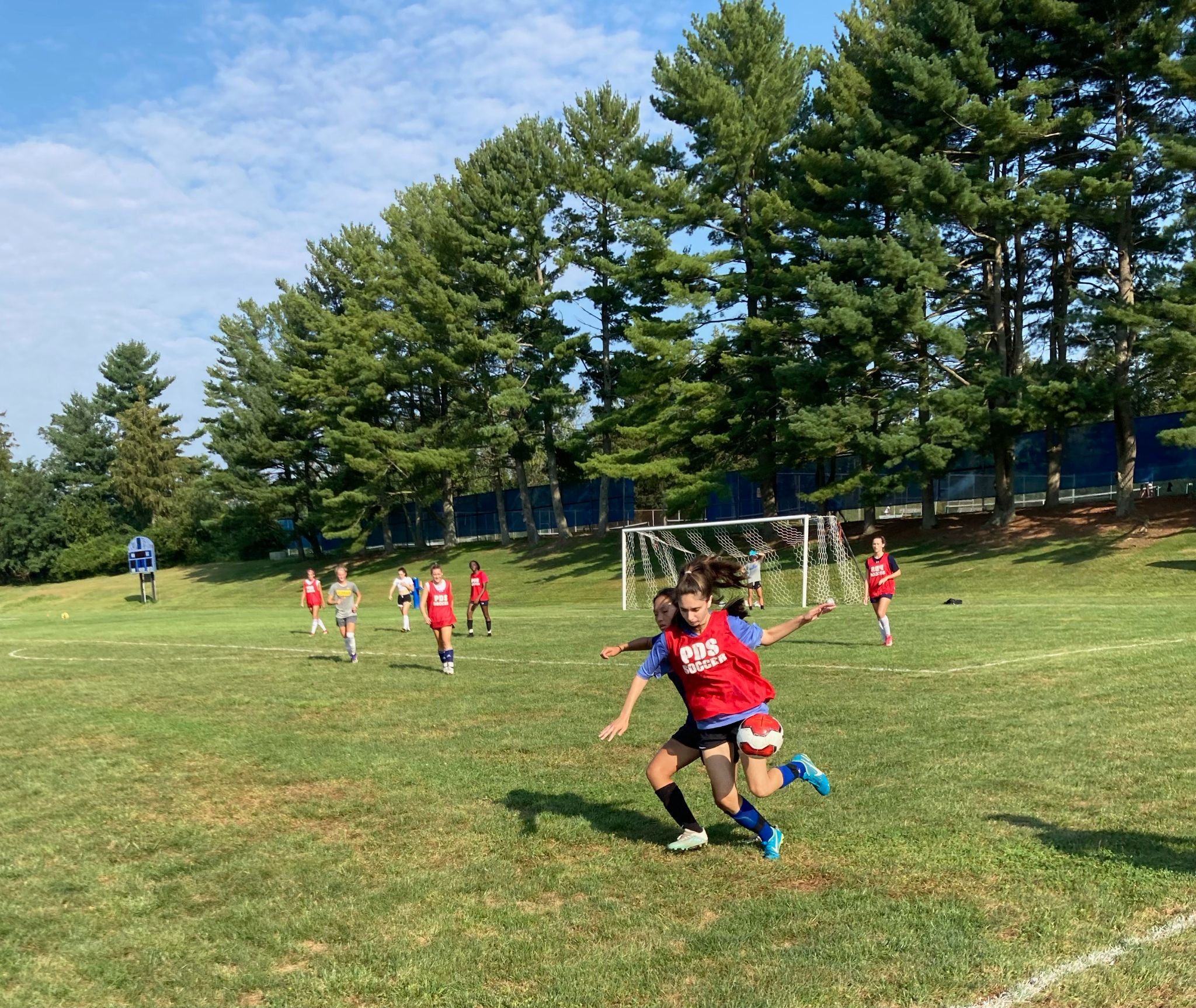 The girls soccer team engages in a scrimmage