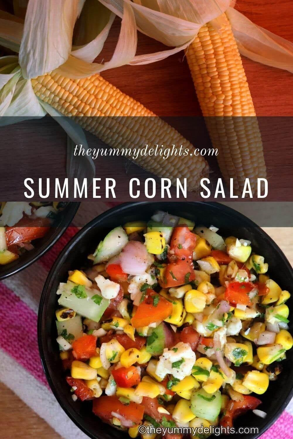 close-up of grilled corn salad in a black bowl. Two fresh corns are placed near the salad bowl.