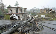 Destroyed houses, cars and power poles, which according to local media were believed to be caused by a tornado, are seen as Typhoon Hagibis approaches the Tokyo area in Ichihara, east of Tokyo, Japan, in this photo taken by Kyodo on October 12 2019.